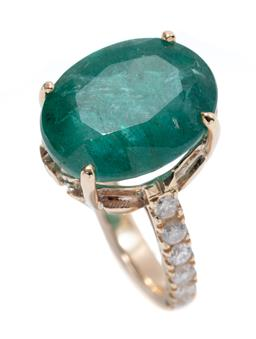 Sale 9213 - Lot 380 - A 9CT GOLD EMERALD AND DIAMOND RING; claw set with an oval cut emerald of approx. 8.50ct to shoulders and gallery set with 14 round...