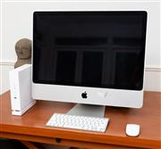 Sale 8694A - Lot 9 - An Apple Mac computer screen size diagonal 62cm including mouse and keyboard, and a Macbook (no leads)