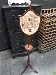 Sale 8598 - Lot 1024 - Georgian Style Pole Screen, the shield shaped panel with a silk stitch panel of a vase with flowers, above a small table section on...
