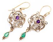 Sale 8991 - Lot 357 - A PAIR OF SUFFREGETTE STYLE GEMSET EARRINGS; 9ct gold Nouveau style scrolling frames set with round cut amethysts and seed pearls to...