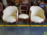 Sale 8539 - Lot 1085 - Pair of Louis XV Style Carved Walnut Tub Chairs, upholstered in a yellow brocade, together with a similar single side chair