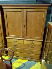 Sale 8634 - Lot 1008 - Late Victorian Oak Press on Chest, with two panel doors enclosing shelves, above five drawers & plinth base