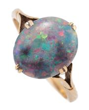 Sale 9066 - Lot 347 - AN ANTIQUE GOLD OPAL RING; split claw set with an oval cabochon black opal with good spectral colours, 11.80 x 9.91 in 17ct gold sha...