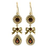 Sale 8991 - Lot 398 - A PAIR OF 9CT GOLD GEM SET EARRINGS IN THE GEORGIAN STYLE; each a cluster centring a round cut garnet within a circle of seed pearls...