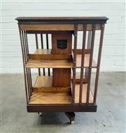 Sale 9085 - Lot 1023 - Late Victorian Ash Revolving Bookcase, of two tiers in contrasting light & dark stain, bearing label for the American Patent Revolv...