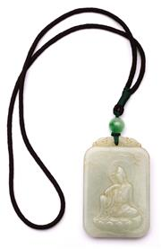 Sale 9078 - Lot 121 - A Green Stone Pendant Featuring Buddha, Engraved marks to verso