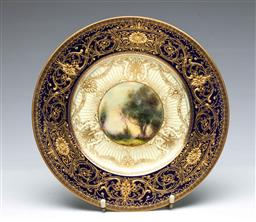 Sale 9093P - Lot 84 - Richly Gilt Royal Worcester Scenic Display Plate Signed Stinton, diam. 26cm.
