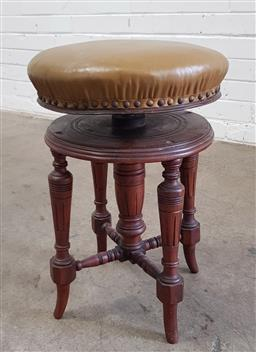 Sale 9097 - Lot 1041 - Late Victorian Walnut Piano Stool, with round olive leather top, raised on turned legs (d:45cm)