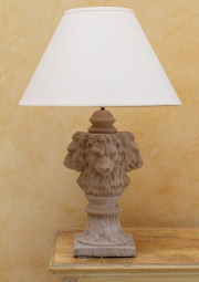 Sale 8677B - Lot 596 - A pair of stone lion form lamps with cream shades each height 82cm