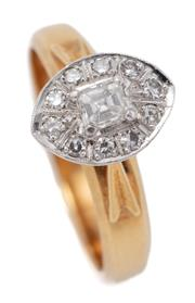 Sale 9066 - Lot 386 - A VINTAGE 18CT GOLD DIAMOND RING; white mount centring a square emerald cut diamond of approx. 0.20ct H/SI, surrounded by 10 single...