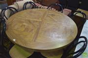 Sale 8390 - Lot 1274 - Round Marquetry Dining Table over Black Legs
