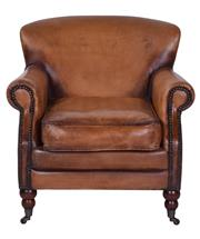 Sale 8957T - Lot 12 - A pair of deep set, extra comfy armchairs featuring  Premium Caramel Leather, with Brass Stud Detailing and Brushed Oak Legs. W: 72...
