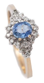 Sale 9066 - Lot 378 - A 9CT GOLD SAPPHIRE AND DIAMOND RING; centring a blue oval sapphire to surround and shoulders set with 18 single cut diamonds, size...