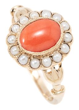 Sale 9145 - Lot 375 - A VICTORIAN STYLE CORAL AND PEARL CLUSTER RING; featuring an oval cabochon coral to seed pearl surround and stylised lotus shoulders...