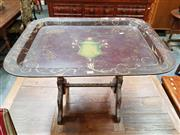 Sale 8848 - Lot 1035 - Probably Victorian Papier Mache Tray Mounted as Table, with green urn & arabesques on a dark chocolate ring, with tilt-top action, o...