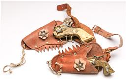 Sale 9131 - Lot 3 - A vintage childrens holster with cap guns - one marked Hopalong Cassidy