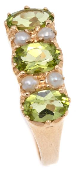 Sale 9145 - Lot 367 - A VICTORIAN STYLE PEARL AND PERIDOT RING; set with 3 oval cut peridots between 4 seed pearls in 9ct gold, size N, top 6 x 17mm, wt....