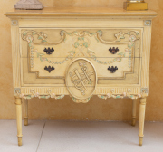 Sale 8677B - Lot 598 - An Italianate chest of two drawers with faux painted marble top over two drawers with central musical motif, applied rose cravings o...