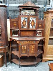 Sale 8848 - Lot 1081 - Late Victorian Inlaid Rosewood Parlour Cabinet, with small mirrored cabinet section, flanked by mirrors and shelves, with a drawer a...