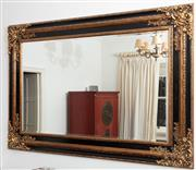 Sale 8990H - Lot 42 - A large rectangular bevelled mirror, the carved black painted frame with gilt highlights, Height 130cm x Width 187cm