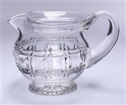 Sale 9003G - Lot 644 - A classic Art Deco heavy hand cut lead crystal footed jug, C: 1940s Ht: 13cm