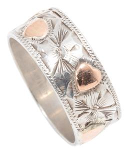 Sale 9145 - Lot 319 - A STUART ARTCRAFT SILVER AND GOLD RING; 7.7mm wide band with engraved flower pattern and applied with 9ct gold hearts, size N, wt. 4...