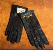 Sale 8420A - Lot 78 - A pair of 1940's soft leather Celine Paris gloves in black with gold plated chain, size: small, condition: excellent