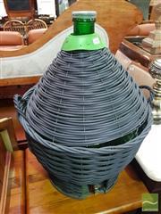 Sale 8495F - Lot 1060 - Large Green Bottle in Basket