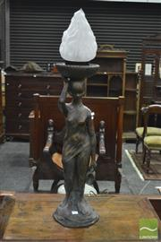 Sale 8345 - Lot 1017 - Cast Water Carrier Lamp, of a lady, with bronzed finish & flame shade