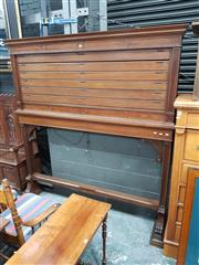 Sale 8868 - Lot 1022 - Early 20th Century Blackwood Map Stand Probably for a Government Department, with carved details and five latches to hold pull-down...