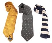 Sale 9080F - Lot 50 - THREE GENTS DESIGNER SILK TIES; a gold Gianni Versace, a grey Armani Collezioni with tag, and a Polo by Ralph Lauren navy and fawn...