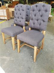 Sale 8601 - Lot 1159 - Set of Four Black Upholstered Button Back Dining Chairs