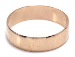 Sale 9246J - Lot 372 - A HEAVY 9CT GOLD BANGLE; width 18.9mm, diam 67mm. wt. 81.06g.