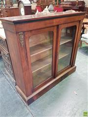 Sale 8559 - Lot 1083 - Victorian Walnut Pier Cabinet, with gilt brass mounts & two arched glass panel doors (Key in Office)