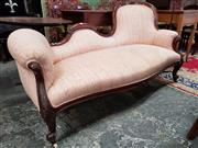 Sale 8792 - Lot 1055 - A Victorian walnut settee with a raised and serpentine back, upholstered in a pink striped fabric and on carved cabriole legs, L 160cm