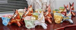 Sale 9103M - Lot 447 - A shelf lot of ceramic donkey figures including lustre finished example.