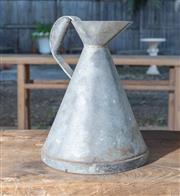 Sale 8745A - Lot 84 - A 19th Century one gallon pewter measuring jug with brass plaque, height 33, width 26cm