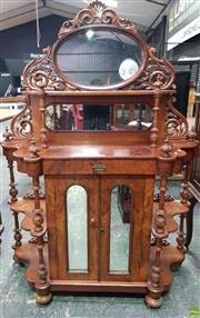 Sale 8559 - Lot 1018 - Victorian Carved & Figured Walnut Combination Chiffonier & Whatnot, with pierced mirror back, open shelves, above a drawer & two arc...
