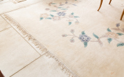 Sale 8677B - Lot 602 - A Chinese woolen carpet with floral motif on an ivory ground, 300 x 460cm