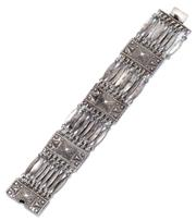Sale 9037 - Lot 327 - A MEXICAN SILVER BRACELET; by FAR FAN, 30mm wide rectangular plaques joined by groups of 8 long oval links to integrated box clasp,...