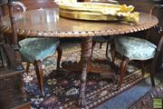Sale 8335 - Lot 1091 - 19th Century Anglo Indian Rosewood Loo Table, the oval top with toothed rim, on a turned possibly padouk pedestal with paw feet, hav...