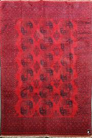 Sale 8728 - Lot 1093 - Afghan Turkoman Wool Carpet, with guls, all in deep red & black tones (300 x 200cm)