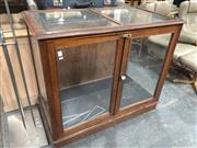 Sale 8822 - Lot 1699 - Cedar Display Cabinet ex. Gowings, with two glass panel doors with brass latch, enclosing one shelf