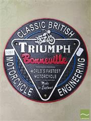 Sale 8465 - Lot 1081 - Cast Iron Triumph Sign