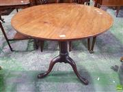 Sale 8559 - Lot 1077 - Georgian Mahogany Wine Table, the round tilt-top on bird-cage pedestal with three outswept feet (possibly adapted)