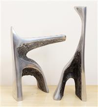 Sale 8963H - Lot 19 - A pair of modern cast aluminium candlesticks/ hanukiah, one stamped AV edition number 18/50, Tallest 35cm