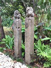 Sale 8706A - Lot 45 - A pair of carved stone temple guardian lion / foo dogs horse hitching post, carved from single pieces of stone, general wear, some c...