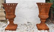Sale 8950G - Lot 61 - Pair of rust patina cast iron lattice urns 70cm Height 40cm diameter
