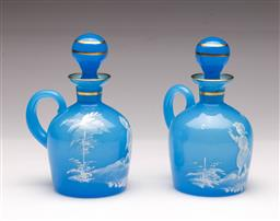 Sale 9104 - Lot 76 - A pair of Mary Gregory style blue glass lidded jugs H 14cm