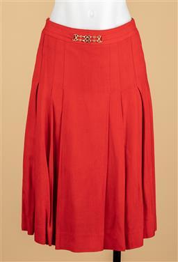 Sale 9250F - Lot 80 - A Celine, Paris pleated red skirt, with gilt decorative belt, size S.